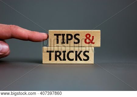 Tips And Tricks Symbol. Wooden Blocks With Words 'tips And Tricks'. Beautiful Grey Background. Busin