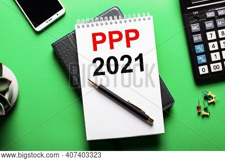 On A Green Background - A Telephone, A Calculator And A Diary With The Inscription Ppp 2021