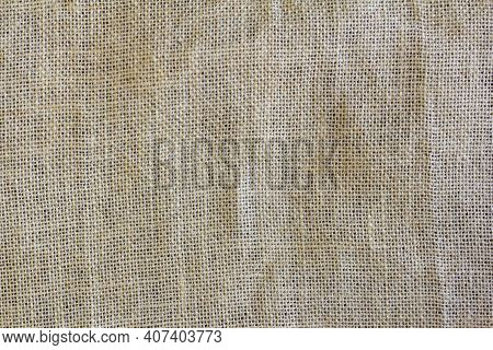 The Texture Of The Burlap. The Background Is Made Of A Very Coarse Fabric, Woven From Jute Or Hemp.