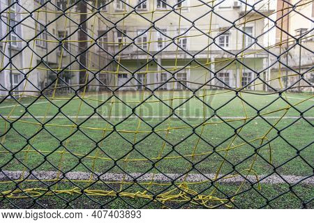 Empty Astro Turf Football Goal Net Behind The Fences In Winter Time Sport Concept In Quarantine