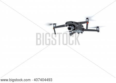 Flying Drone Quadcopter With A Camera Isolated On White Background