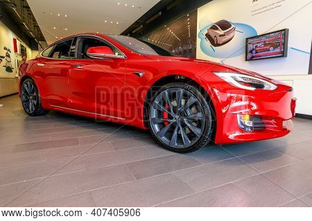 Los Angeles, California, United States Of America - August 21, 2018: Side View Of A Red Tesla Electr