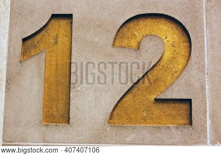 The Number Twelve Carved And Gilded On The Side Of A Stone Office Block In The City Of London.
