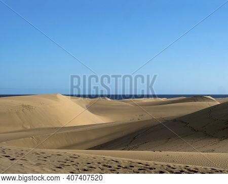 View Of The Natural Reserve Of Dunes Of Maspalomas, Golden Sand Dunes, Blue Sky. Gran Canaria, Canar