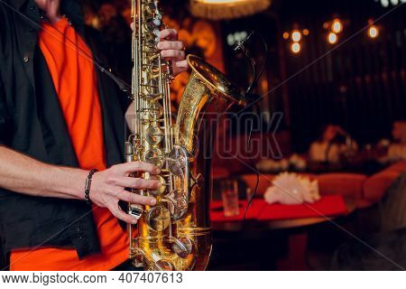 International Jazz Day And World Jazz Festival. Saxophone, Music Instrument Played By Saxophonist Pl