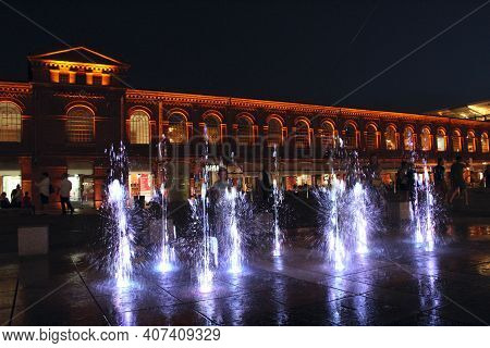 Lodz - Poland. 18 June 2019: Children Play With Night Fountains In The City Of Lodz. Beautiful Eveni