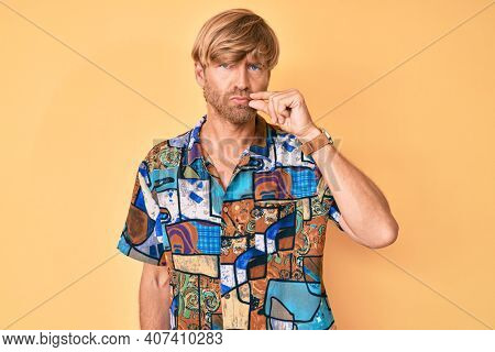 Young blond man wearing summer shirt mouth and lips shut as zip with fingers. secret and silent, taboo talking