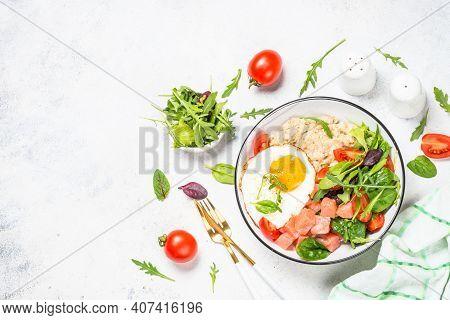 Savory Breakfast. Oatmeal Porrige With Salted Salmon, Egg And Fresh Salad. Healthy Food, Balanced Nu