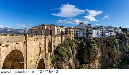 Ronda, Spain - 1 February, 2021: A View Of The Old Town Of Ronda And The Puente Nuevo Over El Tajo G