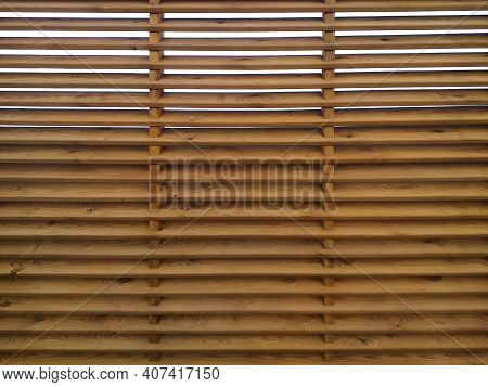 Corrugated Wooden Fence Background With Horizontal Slats. Texture Of Wooden Boards With Holes Ideal