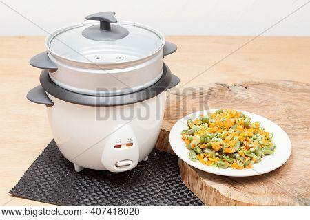 Cooking Utensil; A Multi-purpose Automatic Electric Pot.