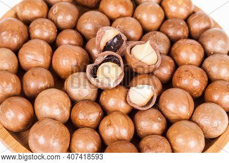 Macadamia Nuts Or Australian Walnuts On White Background.