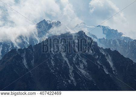 Mountain Snowy Peaks With Clouds On A Sunny Day, Kazakhstan, Prohodnoe Gorge, Tien Shan, Alatau Sunn