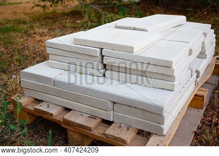 White Stone Paving Slabs Piled Pile For Paving The Pedestrian Sidewalk, Closeup Of Building Material