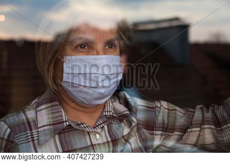 Elderly Caucasian Woman Wearing Handmade Protective Face Mask,nursing Care Home,looking Outside The