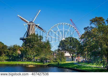 30 September 2015, Leiden, Netherlands: Windmill And Amusement Park In The Centre Of Leiden Before T