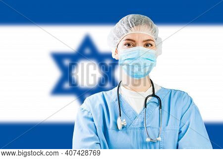 Portrait Of A Caucasian Doctor With Flag Of Israel In Background, Covid-19 Virus Disease Crisis, Cor