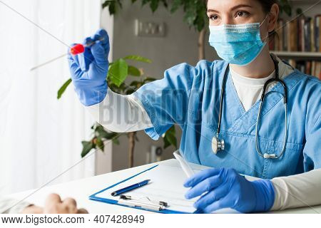 Female Caucasian Doctor Holding A Swab Collection Stick, Nasal And Oral Specimen Swabbing In Doctor'