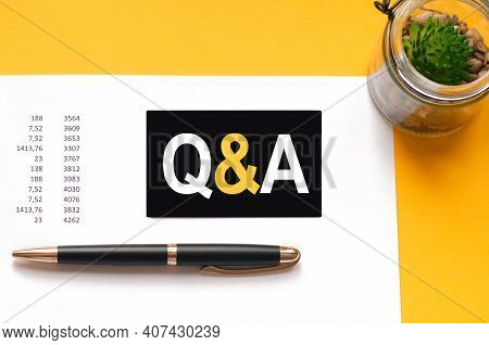 White Paper Card With Text Q And A Sheet Of White Paper For Pen, Flower On The Yellow Background. Bu