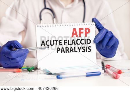Afp Card In Hands Of Medical Doctor. Doctor's Hands In Blue Gloves Holding A Sheet Of Paper With Tex