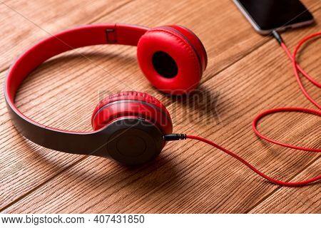 Musical Concept. Stylish Modern Headphones. Red Headphones