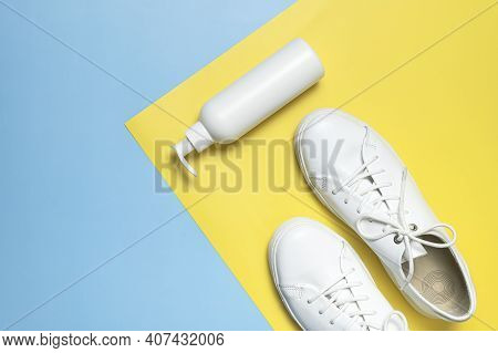 White Leather Sneakers, Plastic Bottles Of Cleaning Products For Shoes On Blue Yellow Background Fla