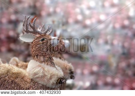 Toy Deer With Shining Antlers, Copy Space Holiday Card, Pink Shining Highlights On The Background