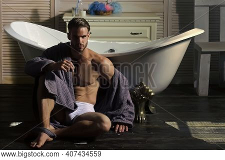 Young Handsome Man With Perfect Skin Hold Perfume Bottle. Man Gay With Nude Body In Underwear, Bathr
