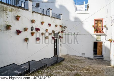 Arcos De La Frontera, Spain - 27 January, 2021: Spanish Architecture Style Buildings With Whitewashe