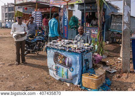 Kolhari, Karnataka, India - November 8, 2013: Roadside Booth Where Male Vendor Sells Home-made Small