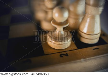 White's Pieces On The Chessboard, Top View. Wooden Chess Pieces On The Chessboard. Intellectual Game