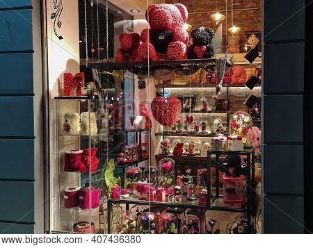 Thessaloniki, Greece - January 31 2021: Valentines Day Flower Shop Windows Showcase. Illuminated Nig