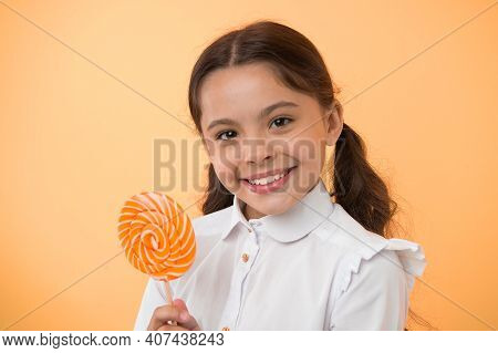 Candy Lollipop Favorite Treats Of Pupil. Having Fun With Candy. Girl Kid Ponytails Hairstyle Eat Swe