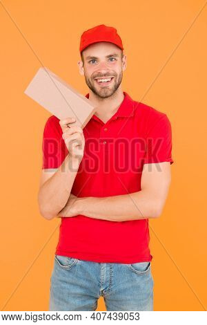 Postman Delivery Worker. Man Red Cap Yellow Background. Delivering Purchase. Delivering Happiness An