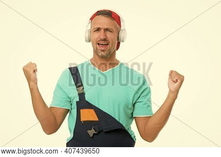 Listen Music For Motivation. Cheerful Worker. Everything Better With Favorite Music. Enjoying Audio