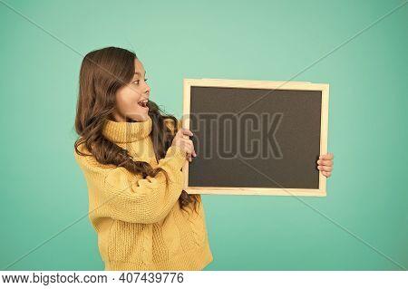 Cute Schoolgirl With Blackboard. Advertisement. Notice Information. Notification Concept. Little Gir