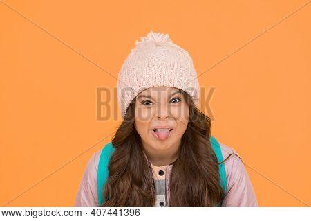 Ugh, Yuck. Little Schoolchild Stick Tongue. Little Kid Make Grimace Yellow Background. Little Girl B