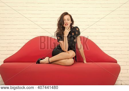 Passion And Lust. Modern Office Life. Sexy Seductress. Glamorous Girl On Couch. Comfortable And Mode