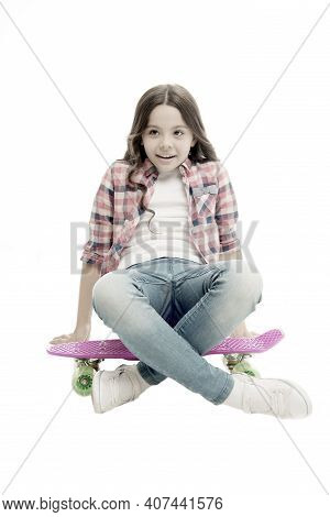 Sit And Relax. Kid Girl Relaxed Sits Penny Board. Learning How To Ride Penny Board. Modern Teen Hobb
