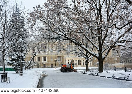 A Snowplow Removes Snow Near The Odessa National Academic Theater Of Opera And Ballet, Architectural