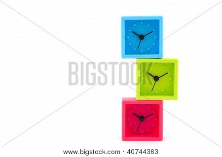 Red, Green, Blue Clocks On White Background