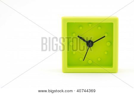 Green Clock On White Background