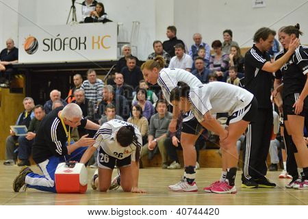 SIOFOK, HUNGARY - JANUARY 5: Unidentified player injured at a Hungarian National Championship handball match Siofok KC (black) vs. Budapest SE (white) January 5, 2013 in Siofok, Hungary.
