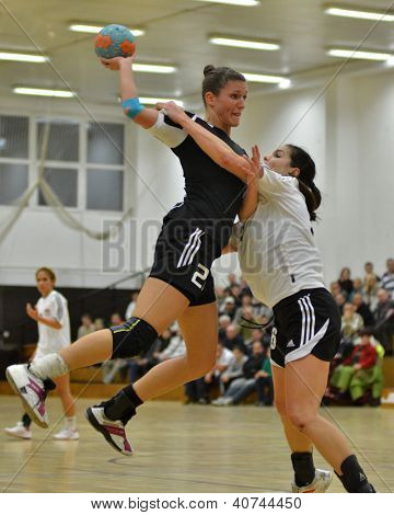 SIOFOK, HUNGARY - JANUARY 5: Csilla Nemeth (in black) in action at a Hungarian National Championship handball match Siofok KC (black) vs. Budapest SE (white) January 5, 2013 in Siofok, Hungary.