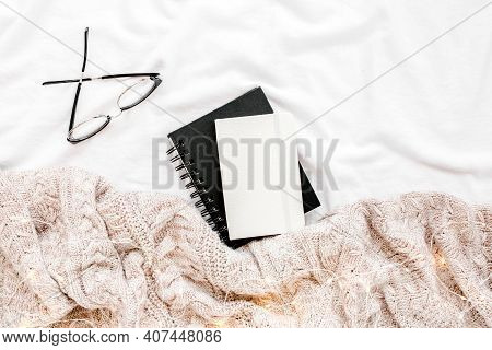 Home Office On Bed With Warm Plaid. Mockup Card. Flat Lay, Top View