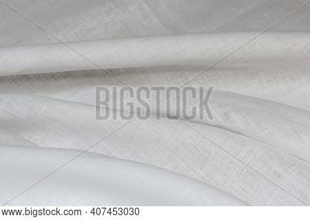 Softened Bleached Linen Sheet Folded On The Bed.