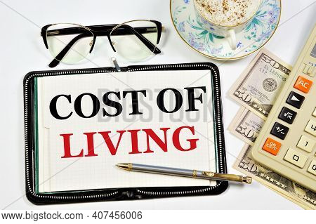 The Cost Of Living. A Text Label In The Planning Notebook. The Calculation Of The Costs Of Home Fina