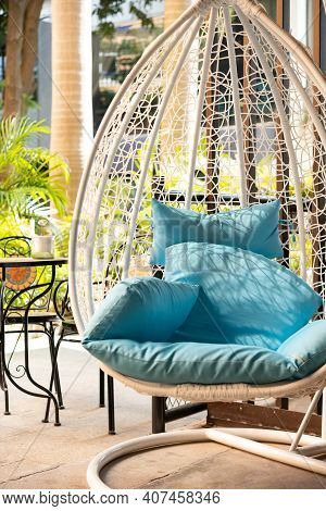 Garden Swing With Mattress And Cushion In The Morning Vertical Composition