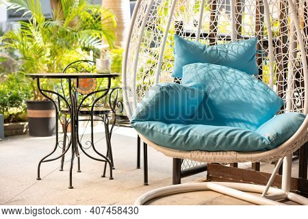 Garden Swing With Mattress And Cushion In The Morning Horizontal Composition