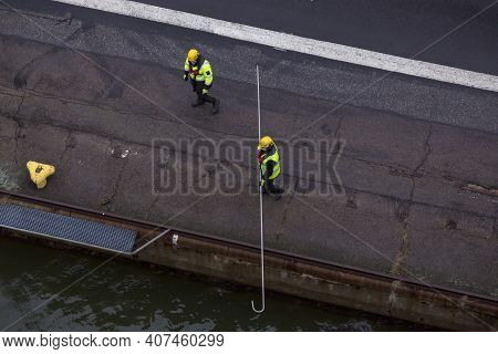 Helsinki, Finland - January 17, 2020: Two Working Ports Provide The Mooring Of A Passenger Ferry In